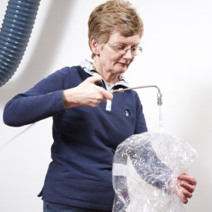Silsoe Odours Laboratory Assistant, Jill Liddle, prepares a sample bag for odour testing.