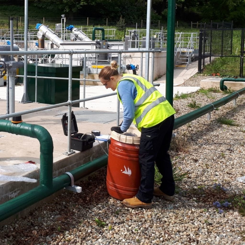 Victoria taking odour samples from a sewage works, demonstrating one of our methods of odour assessment